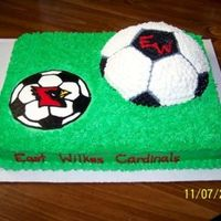 "East High Soccer Cake for my son's end of season soccer party. 11 x 15 cake w/FBCT and 1/2 of the Wilton sports ball. Cake covered in b/c ""grass&..."