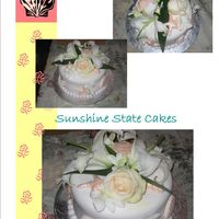 Pretty Shells And Flowers This cake was made for a small wedding. Sugar Shells made in a chocolate mold and then taken out, dried, airbrushed with ornage pink and...