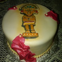 Tumi Cake this cake has a peruvian god gracing the top with drapping in red to look like the peruvian flag... tumi cake