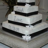 Live Laugh Love Buttercream with black ribbon and fondant flowers.