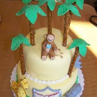 Curious George This cake was for my son's 2nd birthday. It's based off his favorite book: Curious George feeds the animals. MMF with pretzel rod...