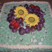 Mother's Day Fruit and Flowers Basket. The sunflowers are in gum paste and place some grapes too. The color is avocado and use the tips 48 and 18.This...
