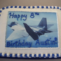 F-22 Raptor Cake This is a root beer flavored cake with vanilla buttercream. The picture is an edible image of a F-22 Raptor that my son requested.