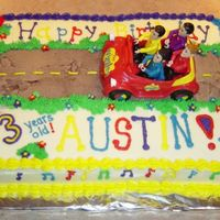 The Wiggles Decorated with buttercream. Car and figures were toys for the birthday boy.