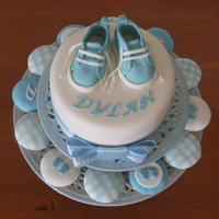 Dylan Baby Topper & Cupcakes Foam Topper made for display. Boots are gumpaste using pattern from CC. Cupcakes vanilla with fondant tops in various styles.