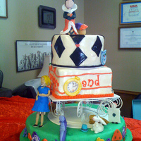 Alice In Wonderland This Alice In Wonderland cake was made for a student in my second grade class. It was for her big adoption bash with an Alice theme. The...