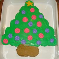 Chistmas Tree Cupcake Cake Set up cupcakes to look like a tree, ice top all but bottom two green, ice bottom two brown, pipe star on top cupcake, and then add random...
