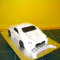 Maserati Care My attempt at a Maserati car. Not so happy w/ the end result, but ok. TFLfondant covered vanilla/choc cake