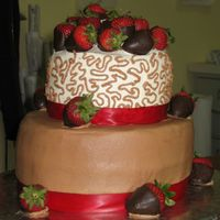 Chocolate Strawberry Cake This was my first stab at cornelli lace. I frosted two chocolate cakes with buttercream frosting then topped it with chocolate dipped...