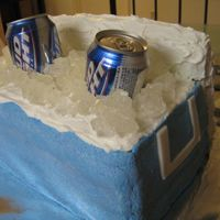 Ice Chest With Beers Stacked rectanguler layers of white cake, covered in blue buttercream (white on top). Fondant handles and frosted rice krispie treat lid....
