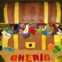 Pirate Treasure Chest For a 3 year old's pirate theme birthday party, I made this treasure chest cake out of a 12x18 layer cut in half then stacked. Frosted...