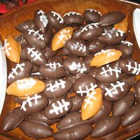 Football Cake Balls I used the same cake ball recipe that we all use for Christmas, but shaped them into footballs and used store bought icing to draw on laces...