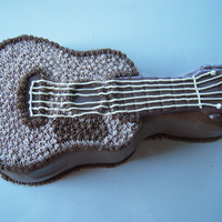 Guitar Cake Guitar cake using Wilton cake pan. Chocolate cake with peanut butter buttercream. Melted chocolate accents.