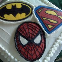 Superhero Cake  BCFT transfers of the superhero symbols and Spiderman's face. I piped the lines onto Spiderman after it was transferred to the cake. I...