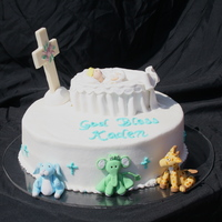 Baptism Cake Yellow cake with chocolate chip cookie dough buttercream filling iced in buttercream. Fondant animals and cradle with baby. White chocolate...