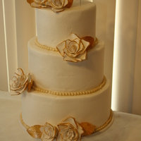 50Th Anniversary Cake 3 tier fondant covered with gold accents and sugar roses