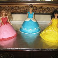 Three Favorite Princesses My best friend's daughter couldn't decide which princess, so we just went with three! Made with Wilton cake pan and buttercream...