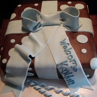 Baby Shower Gift Box   Covered in chocolate fondant with fondant bow and polka dots.