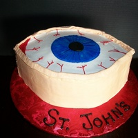 Eyeball Cake Eyeball Cake for Optometrist's office. Flesh colored fondant and colored piping gel for iris.