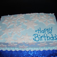 Snowflake Birthday Sheet cake iced in BC. Snowflakes are cut out of fondant and covered in white sparkles to give the glistening effect.