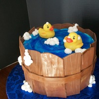 "Rubber Ducky Baby Shower  ""Wood"" is fondant strips with grooves dragged across. Buttercream ""bubbles"" and colored piping gel ""water.""..."