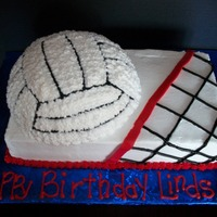 Volleyball Birthday   Birthday cake for volleyball coach. Double layer cake w/half sports ball, all BC.
