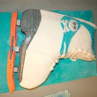 Figure Skate Two layers of chocolate cake covered in buttercream and deluxe rolled ice fondant. For my friends daughters skating party. It was a HUGE...