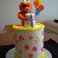 "Elmo Three 6"" layers frosted with buttercream and fondant accents. Elmo is rice krispie treats covered with gumpaste and fondant mix."