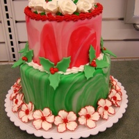 Red And Green Magic I made this as a display for the store I work at. Marbelized the fondant, royal icing petunias (without the stamens) and roses on the top