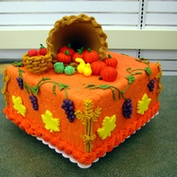 Fall Festival This is a display for the store I work at. The fruits and vegetables are all gum paste, the cornucopia is made with royal icing over a snow...