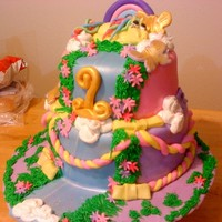 My Little Pony , Fairy Tale First Birthday Father designed this - this is the colors he wanted its a 9in and 8in tiered , all fondant all edoble - my first fondant figure - I am not...