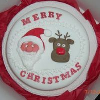 Christmas Cake plaque was made during night school but collegue liked it so much i put it on a cake for her. Father Christmas looks as though he has had...