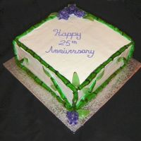 25Th Anniversary Bamboo Cake White cake with whipped raspberry filling. Buttercream icing. Rolled buttercream bamboo. Gumpaste chrysanthemums and leaves. This took me a...