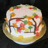 Autumn Leaves Orange cake torted with cream cheese icing, iced with buttercream. Gum paste leaves and tree branches.