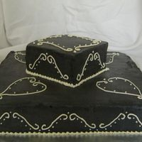 "Black White Scroll Tiered Cake This was the cake I made for our 10th Anniversary! My husbands favorite, white cake with chocolate buttercream icing 10"" bottom cake...."
