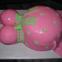 Pregnant Belly Bump Strawberry cake with buttercream covered in MMF with MMF decorations. First time I have done one of these without the sheetcake under it. I...