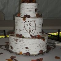 Birch Logs And Fall Leaves triple stacked birch logs with chocolate walnuts,acorns, other nuts, and edible rice paper fall leaves scattered on layers Cake was 3...