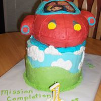 Rowan's Rocket Birthday cake based on little einsteins, Rocket, for grandson's 1st birthday. Everything is edible except the laminated character...