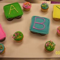 Baby Shower Cupcake Cake 24 cupcakes all bc with ribbon and sprinkles on the extra cupcakes