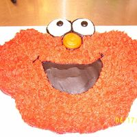 Elmo 24 cupcakes with bc. i made all the elmo fur with the grass tip #233