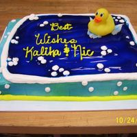 Baby Shower 1/2 sheet white cake, color mist spray under bc decorations. plastic rubber ducky