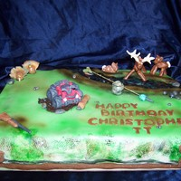 Sportsman Cake White cake with Strawberry Filling. Done for a boy that loves to hunt, fish, and four wheel! He didn't want to cut the cake, so I...