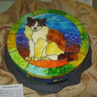 Stained Glass Kitty  This is one of my most favorite cakes! It is a 14 inch dummy covered in fondant then I did an image transfer with piping gel off of a...