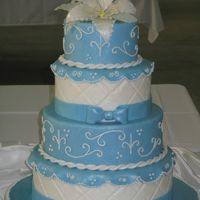 Blue Cake My cake for the Great American Cake Show 2009. 6-8-10-12 inch styrofoam dummies covered in rolled fondant. Piping was done in royal icing...