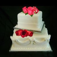 "The Wedding That Wasn't. This is the cake for the wedding that was cancelled. Off set 10"" and 6"" squares. with 1.5"" seperation. Roses are..."