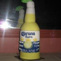 "Happy Birthday Bruce! Corona bottle for a friends 31st b-day. 6"" rounds stacked and carved with RCT ""neck"" and gumpaste lime. Covered in fondant..."