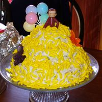 Curious George Three tier confetti cake, confetti icing, and lots of candy bananas.