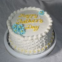 Dsc06838.jpg  This is my first basketweave cake that I made for my father. I used a buttercream frosting with royal icing flowers. I used white so that...