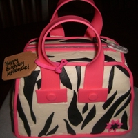 Zebra Purse Cake zebra purse cake for a 9 year old's birthday. Tried to copy the BEAUTIFUL one done by supakiki- did not do it justice, but the...
