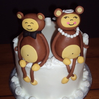 Monkey Lovers Anniversary Buttercream icing. Monkey 50/50. Veil, necklace and bow gumpaste.